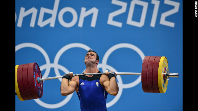 Greece's David Kavelasvili competes during the men's 94-kilogram group B weightlifting event.