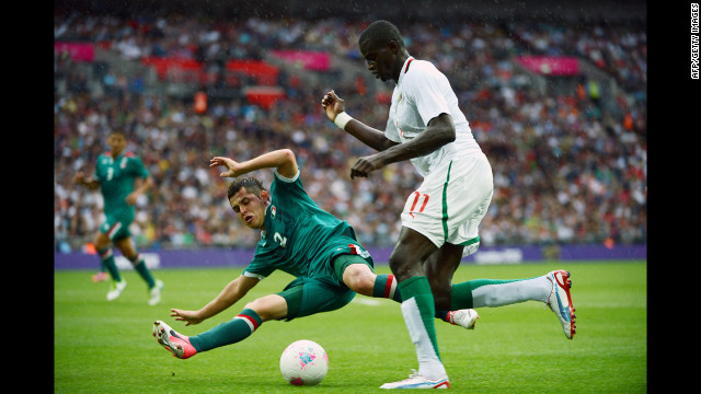 Mexican defender Israel Jimenez, left, challenges Senegalese forward Kalidou Yero in a men's football quarterfinal match at Wembley Stadium in London.