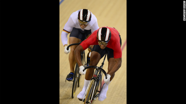 Robert Forstemann of Germany, left, competes against Njisane Nicholas Phillip of Trinidad and Tobago during the men's sprint round-of-eight cycling event.