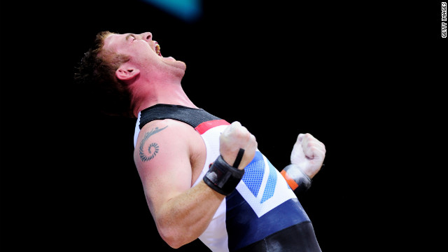 Peter Kirkbride of Great Britain competes in the men's 94-kilogram weightlifting final.