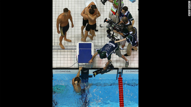 Clockwise: Matthew Grevers, Brendan Hansen, Michael Phelps and Nathan Adrian react to winning gold in the men's 4x100-meter medley relay.