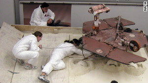 Scott Maxwell, top, Kim Lichtenberg, left, and Pauline Hwang test how to get Spirit out of a Martian \