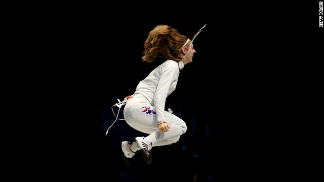 Susannah Scanlan of the United States celebrates her team's 31-30 victory against Russia in the bronze medal match in women's epee team fencing.