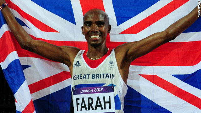 Mo Farah celebrates his stunning victory in the men's 10,000 meters at the Olympics Stadium. 