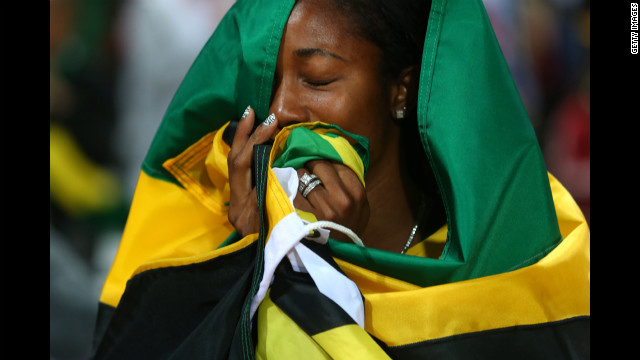 Shelly-Ann Fraser-Pryce of Jamaica celebrates winning the gold in the women's 100m final.