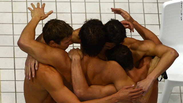 The U.S. swimming team reacts to winning gold in the 4x100-meter medley relay.