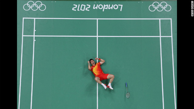 Haifeng Fu of China celebrates a victory in the men's doubles badminton semifinal match Saturday against Boon Heong Tan and Kien Keat Koo of Malaysia.