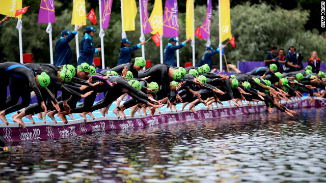 Athletes dive into the water at the start of the women's triathlon at Hyde Park.