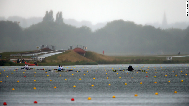 From left, Sara Mohamed Baraka and Fatma Rashed of Egypt, Maria Clara Rohner and Milka Kraljev of Argentina, and Luana De Assis and Fabiana Beltrame of Brazil compete in the lightweight women's double sculls finals at Eton Dorney in Windsor.