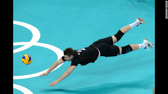 Germany's Markus Steuerwald dives for the ball during the men's preliminary volleyball match between Germany and Tunisia.