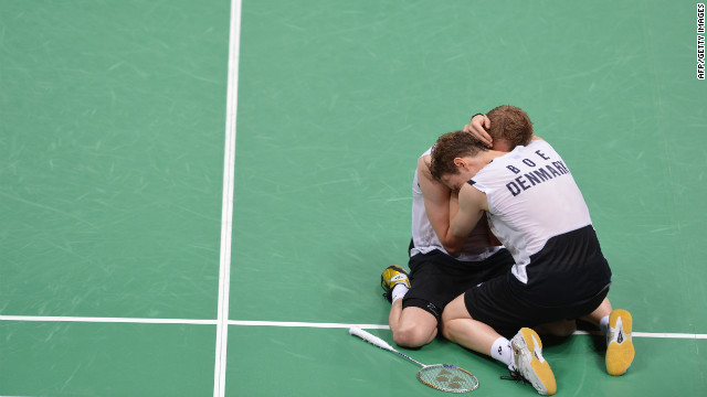 Denmark's Mathias Boe and Carsten Mogensen celebrate their victory over Chung Jae Sung and Lee Yong Dae of South Korea during the semifinal men's doubles badminton match. Check out photos from<a href='http://www.cnn.com/2012/08/05/worldsport/gallery/olympics-day-9/index.html' target='_blank'> Day 9 of the competition </a>on Sunday, August 5.