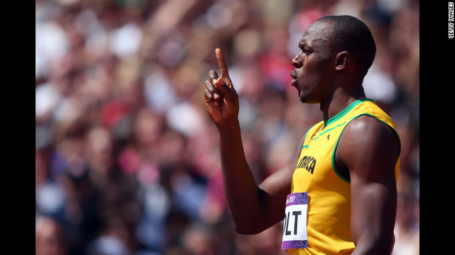 Usain Bolt of Jamaica signals a No. 1 after competing in the men's 400-meter round 1 heat.