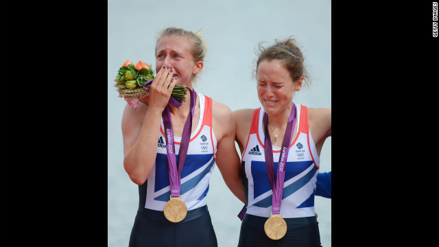 Katherine Copeland and Sophie Hosking of Great Britain celebrate with their gold medals during the medal ceremony for the lightweight women's double sculls.