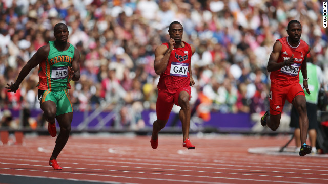 Gerald Phiri, left, of Zambia, Tyson Gay, center, of the United States and Richard Thompson of Trinidad and Tobago compete in the Men's 100-meter Round 1 Heats.