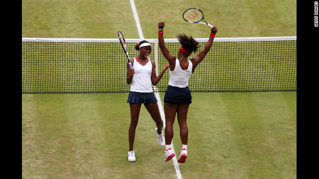 The sisters celebrate after their victory against the Czech players Sunday.