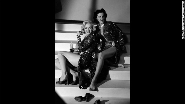 "Marilyn Monroe and Jane Russell on the set of 1953's ""Gentlemen Prefer Blondes."" See more from this series at LIFE.com."