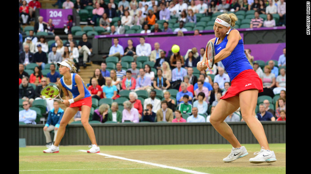 The Czech Republic's Andrea Hlavackova, left, and Lucie Hradecka, right, play against Venus and Serena Williams of the United States during the women's doubles gold medal match in Wimbledon.