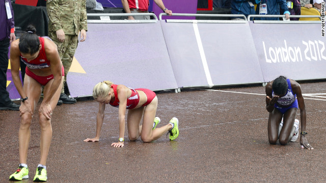 Namibia's Helalia Johannes, right, and other competitors begin to recover after finishing the women's marathon.