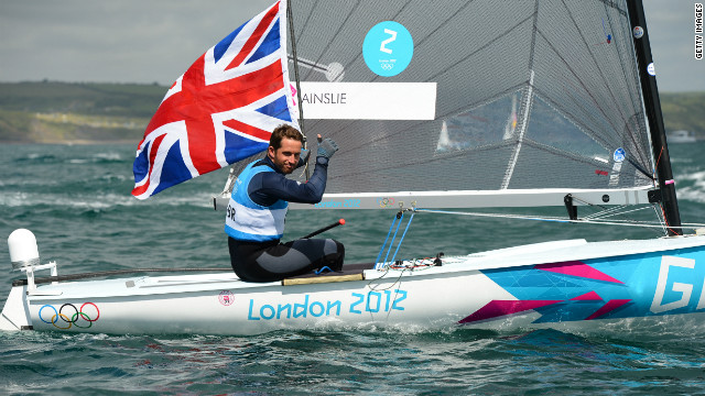 Britain's Ben Ainslie celebrates after winning his fourth successive gold medal in the Finn class