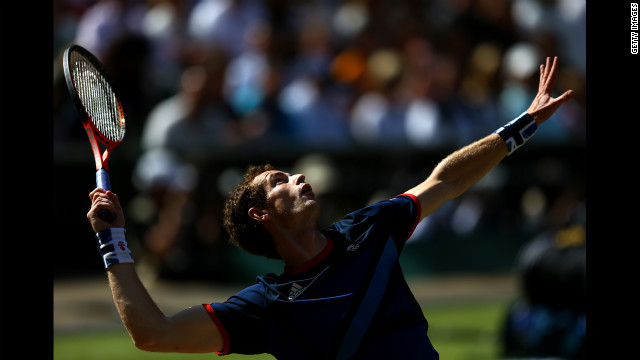 Andy Murray of Great Britain serves the ball to Roger Federer of Switzerland during the men's singles tennis gold medal match. Murrary went on to win the match.