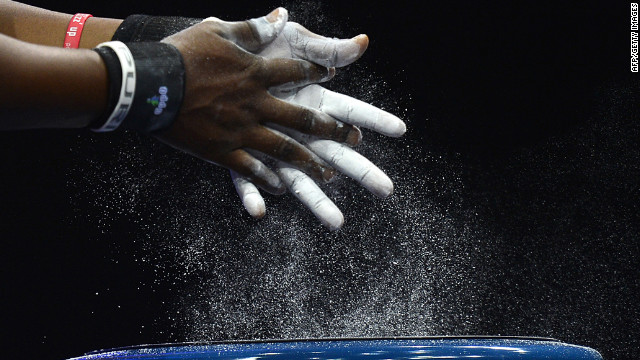 Ghana's Alberta Boatema Ampomah prepares her hands before competing in the women's 75-plus kilogram group A weightlifting event.