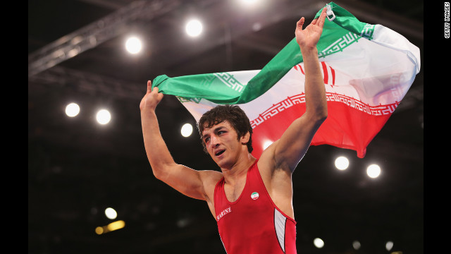 Hamid Mohammad Soryan Reihanpour of Iran celebrates winning the gold medal in the men's Greco-Roman 55 kilogram wrestling bout.