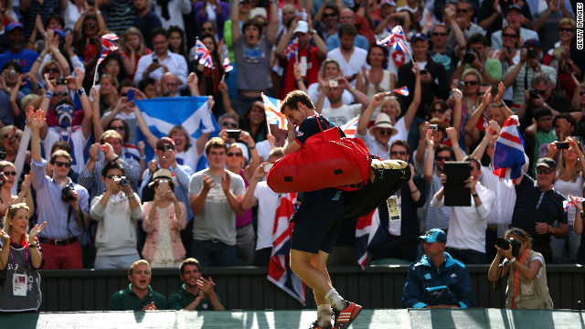 Andy Murray of Great Britain walks off the court after defeating Roger Federer of Switzerland and winning the gold medal in the men's singles tennis competition.