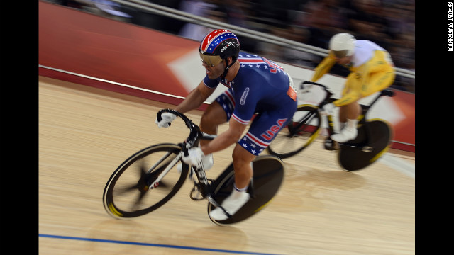 Jimmy Watkins, left, of the United States and Shane Perkins, right, of Australia fly around the track during the men's sprint quarterfinals cycling event.