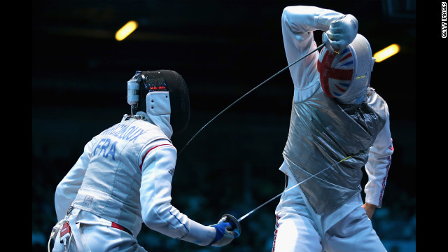 Marcel Marcilloux of France strikes Richard Kruse of Great Britain during the men's foil team fencing match.