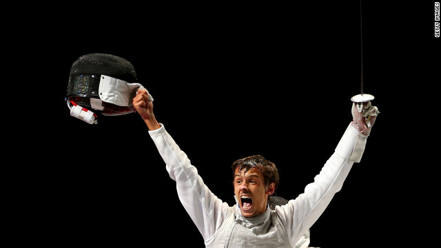 Andrea Baldini of Italy is joyous after defeating Kenta Chida of Japan to win the gold medal in the men's foil team fencing.