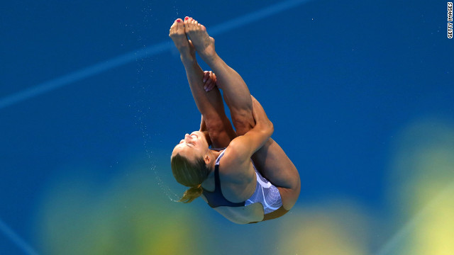  Tania Cagnotto of Italy performs an acrobatic dive in the women's 3-meter springboard diving final.