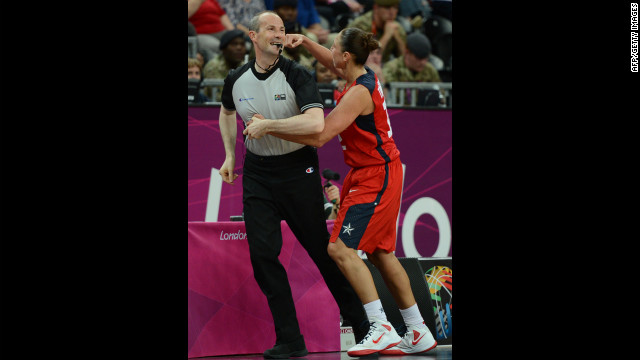 U.S. basketballer Diana Taurasi decks an unsuspecting referee after a call goes against her.