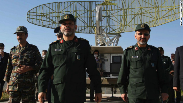Defense Minister Ahmad Vahidi (C, file photo) said that the test launch of the new Fateh-110 missile was a success.