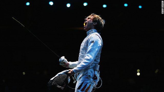 Peter Joppich of Germany celebrates beating Alexey Cheremisinov of Russia during the men's foil team fencing quarterfinal. Check out photos of Day 10 of the competition from Monday, August 6.