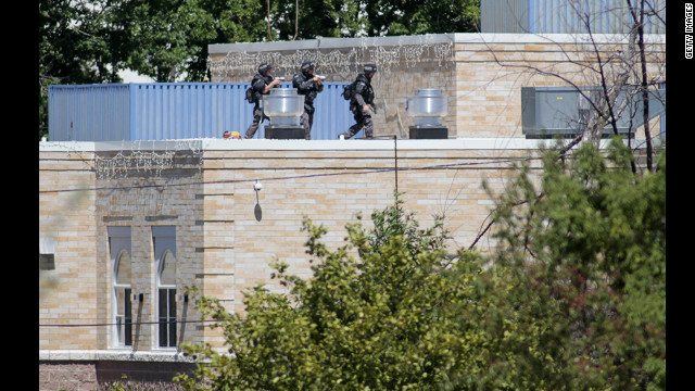 SWAT officers surround a Sikh temple in Oak Creek, Wisconsin, where a gunman whom authorities identified as Wade Michael Page, 40, stormed the building and opened fire on Sunday, August 5. The incident left six people and the gunman dead.