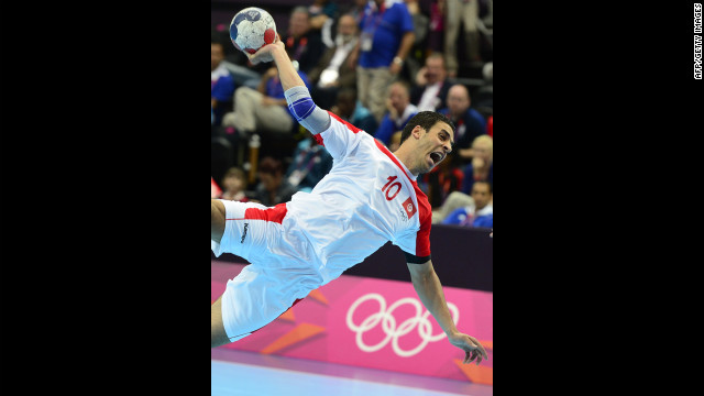 Tunisian centerback Kamel Alouini shoots during the men's preliminary Group A handball match against Argentina on Monday.