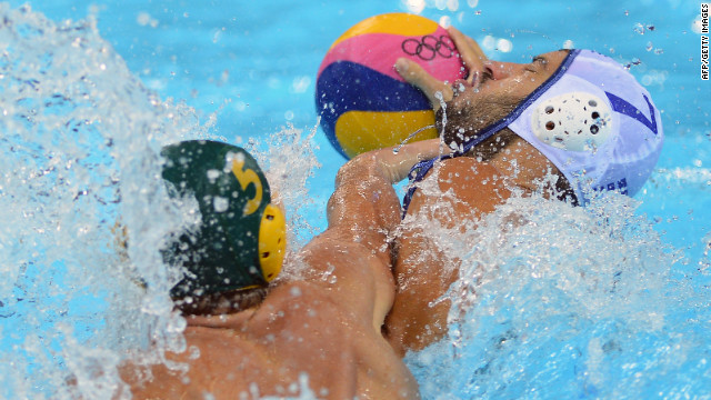 Greece's Christos Afroudakis, right, is challenged by Australia's Aaron Younger during the men's water polo preliminary round match at the Water Polo Arena.
