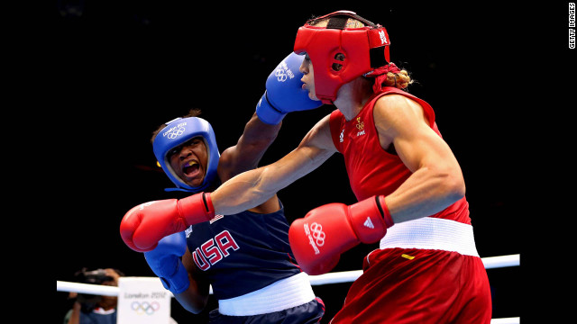 Claressa Shields of the United States, left, squares off against Anna Laurell of Sweden during the women's middle 75-kilogram boxing quarterfinals.
