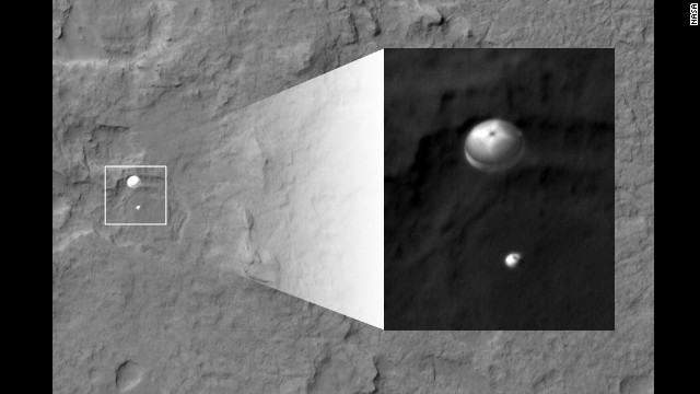 NASA's Curiosity rover and its parachute were spotted by NASA's Mars Reconnaissance Orbiter as Curiosity descended to the surface on Sunday. The rover landed early on August 6 (ET).