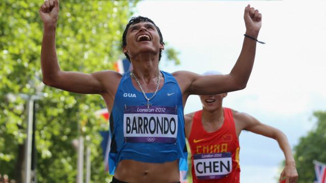 Race walker Erick Barrondo celebrates as he crosses the finish line to win a silver medal for Guatemala on August 4.