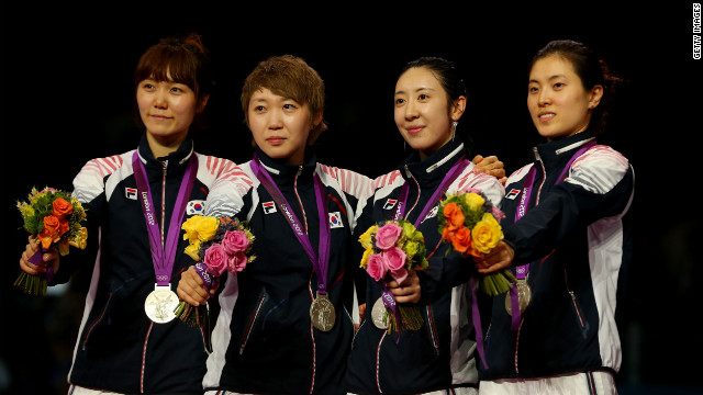 Silver medalists Eunsook Choi, Injeong Choi, Hyojung Jung and Shin A Lam celebrate after the Women's Epee Team Fencing Finals on August 4.