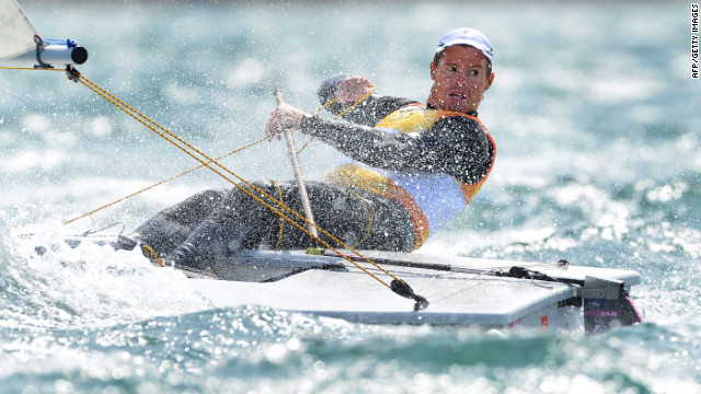 Australia's Tom Slingsby looks back at his rivals as he takes gold in the laser sailing class competition.