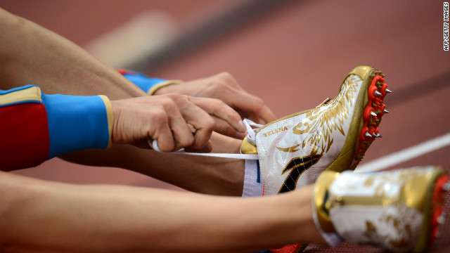Russia's Yelena Isinbayeva laces her shoe before competing in the women's pole vault final.