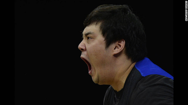 South Korea's Kim Whaseung shouts as he competes during the men's 105-kilogram group A weightlifting event.