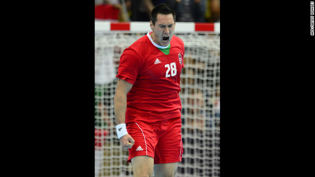 Timuzsin Schuch of Hungary celebrates a goal in the men's preliminary Group B handball match against Serbia.