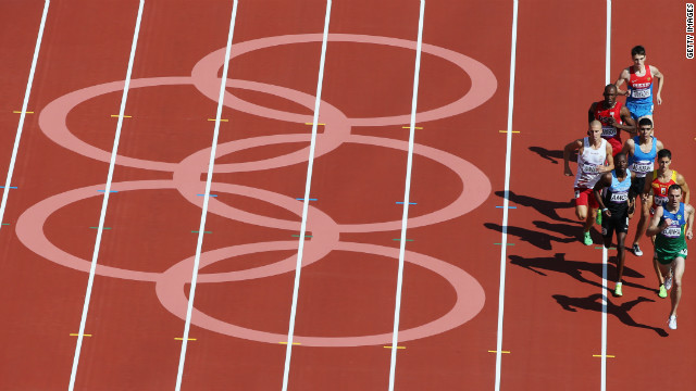 Athletes race in the men's 800-meter heat Monday.