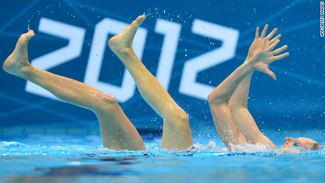 A synchronized swimmer performs her routine in 4 inches of water.