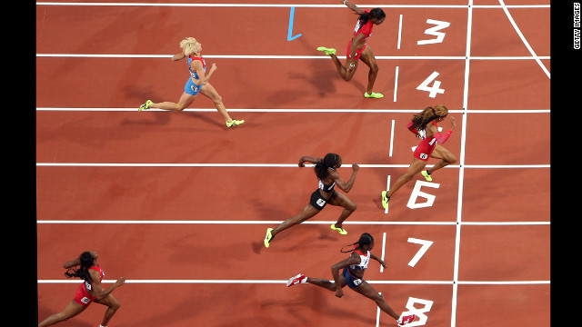 Richards-Ross crosses the line to win the gold.