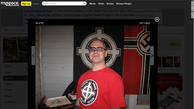 Wade Michael Page wears a white power T-shirt in front of white power and Nazi flags on a Myspace page.