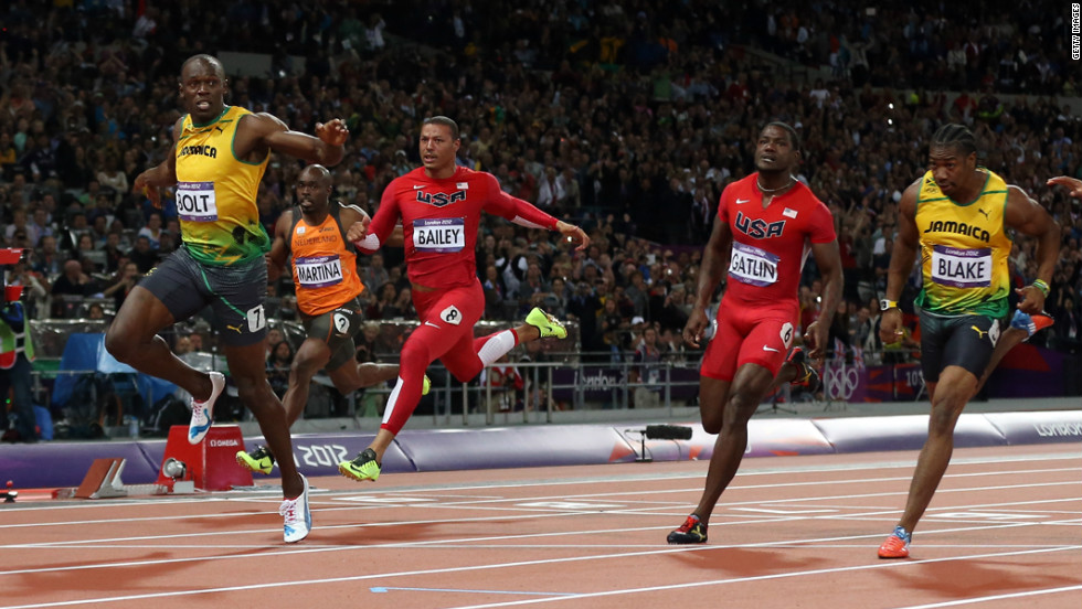 With a time of 9.63 seconds, Usain Bolt of Jamaica wins the gold in the men's 100-meter final on Sunday, August 5. Check out &lt;a href='http://www.cnn.com/2012/08/04/worldsport/gallery/olympics-day-8/index.html' target='_blank'&gt;Day 8 of competition&lt;/a&gt; from Saturday, August 4. The Games ran through August 12. 